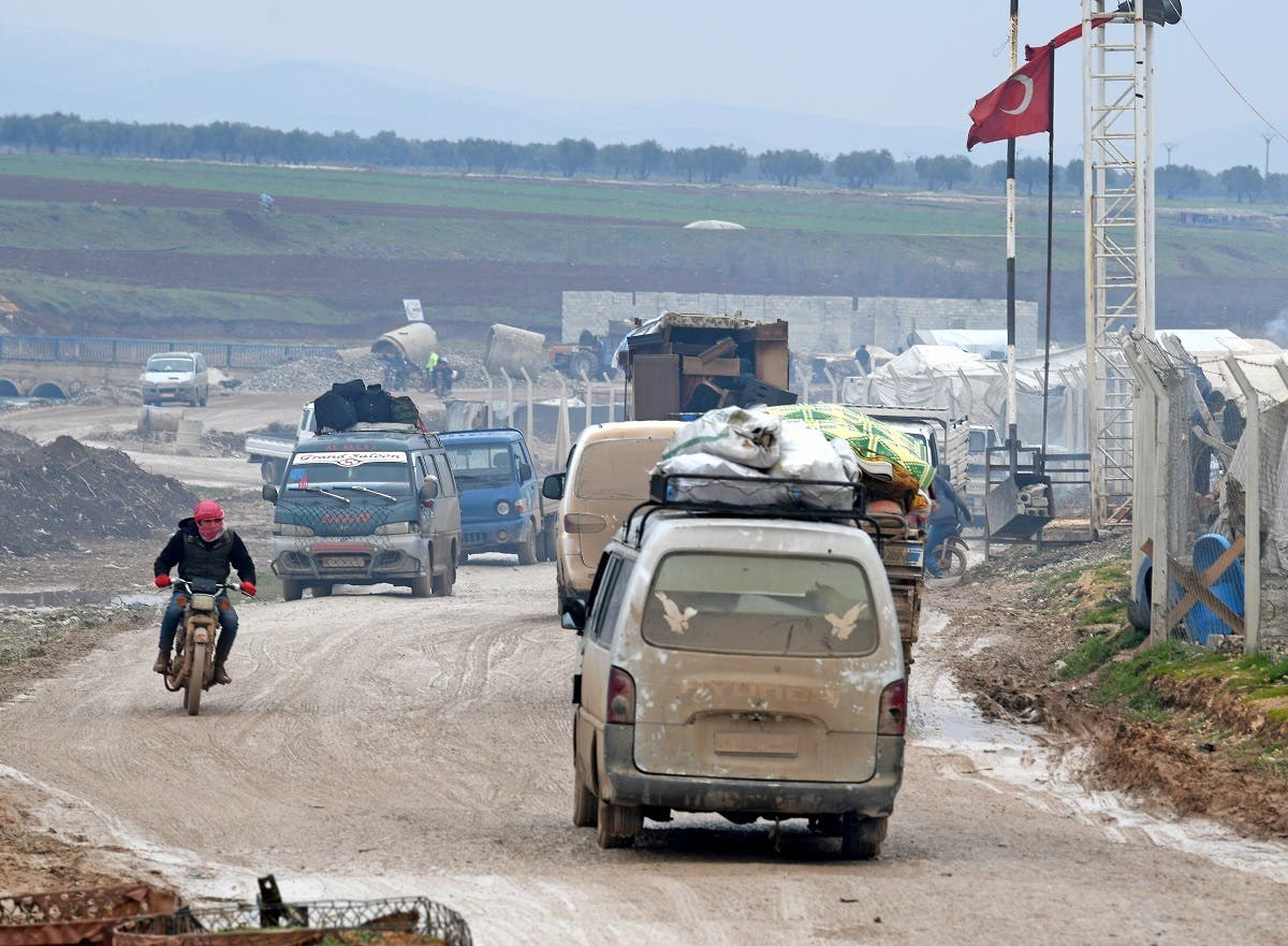 Displaced Syrians flee the countryside of Aleppo and Idlib provinces towards Syria's northwestern Afrin district near the border with Turkey on February 13, 2020. (AFP)