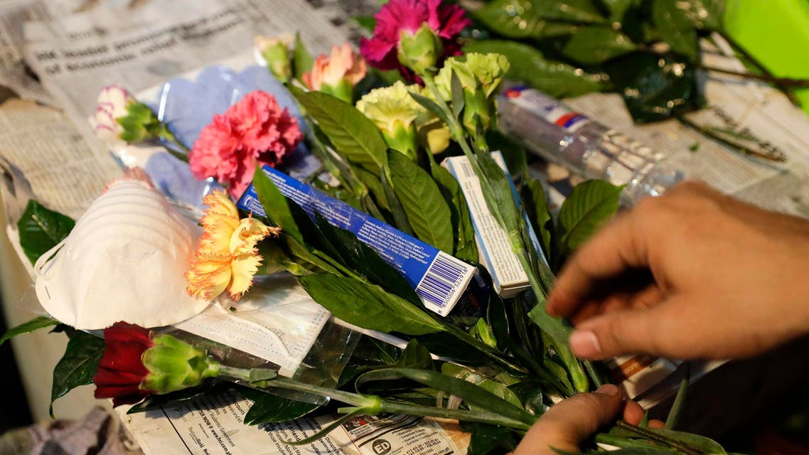 "A man arranges a Valentines flower arrangement which they called ""anti-nCoV bouquet"" in Manila on Feb. 13, 2020. (AP)"