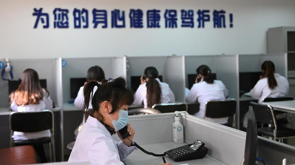 A hotline operator for a free counselling service answers a phone while wearing a face mask, as the country is hit by an outbreak of the novel coronavirus, in Shenyang, Liaoning province, China February 12, 2020. (Photo: Reuters)