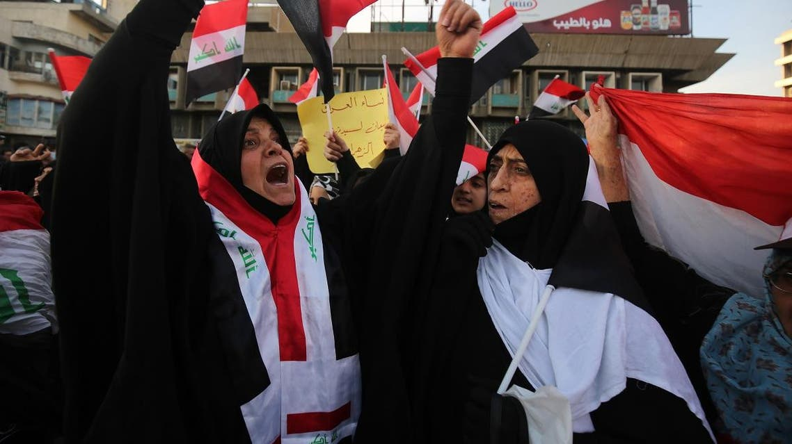 Iraqi women, followers of the cleric Moqtada al-Sadr, demonstrate among thousands of other supporters in the capital Baghdad's Tahrir Square on February 14, 2020. (AFP)