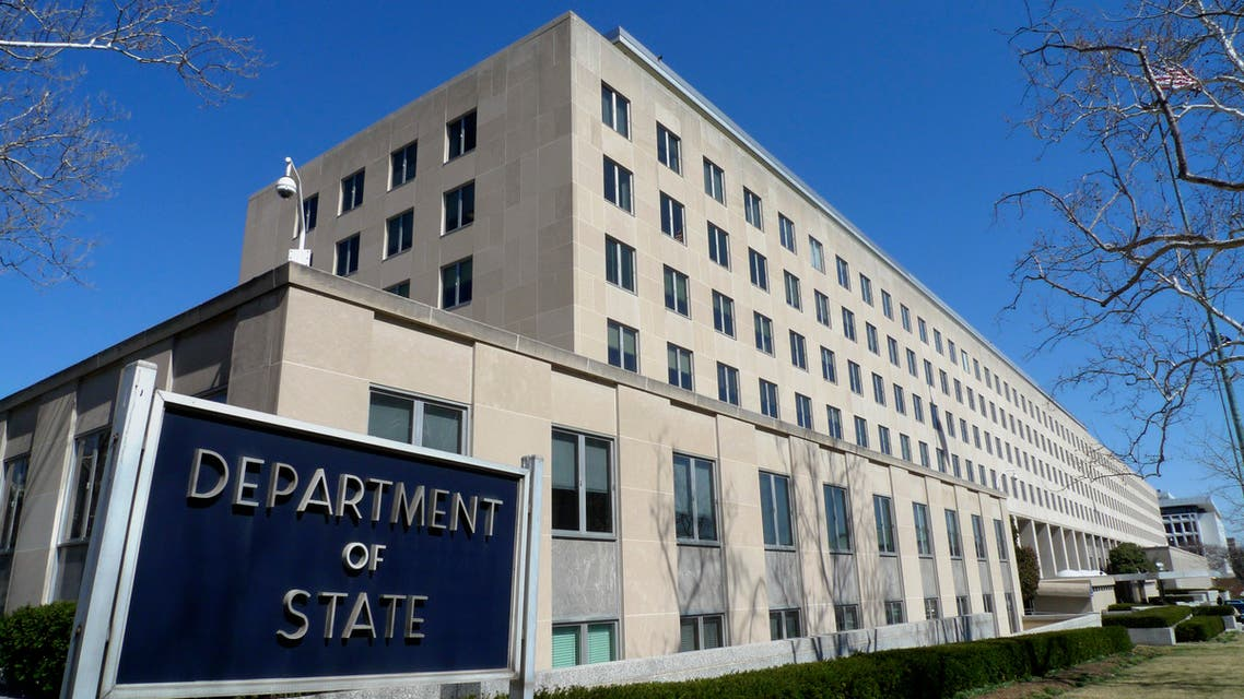 File - The Harry S. Truman Building, headquarters for the State Department, is seen in Washington, in this March 9, 2009 file photo. A retired State Department worker, Walter Kendall Myers and his wife Gwendolyn Steingraber Myers, have been arrested on charges of spying for Cuba for three decades, using grocery carts among their array of tools to pass U.S. secrets to the communist government in a security breach one official described as incredibly serious. The indictment was unsealed Friday June 5, 2009. (AP Photo/J. Scott Applewhite, File)