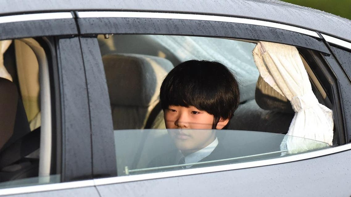 A vehicle carrying Prince Hisahito, son of Prince Akishino and Princess Kiko, leaves the Imperial Palace in Tokyo on April 30, 2019. (AFP)