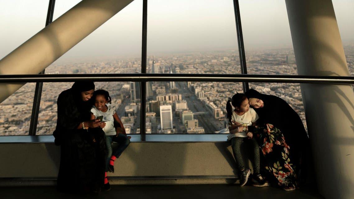women hold their daughters as they visit the Four Seasons Skyline Tower, in Riyadh, Saudi Arabia. (AP)