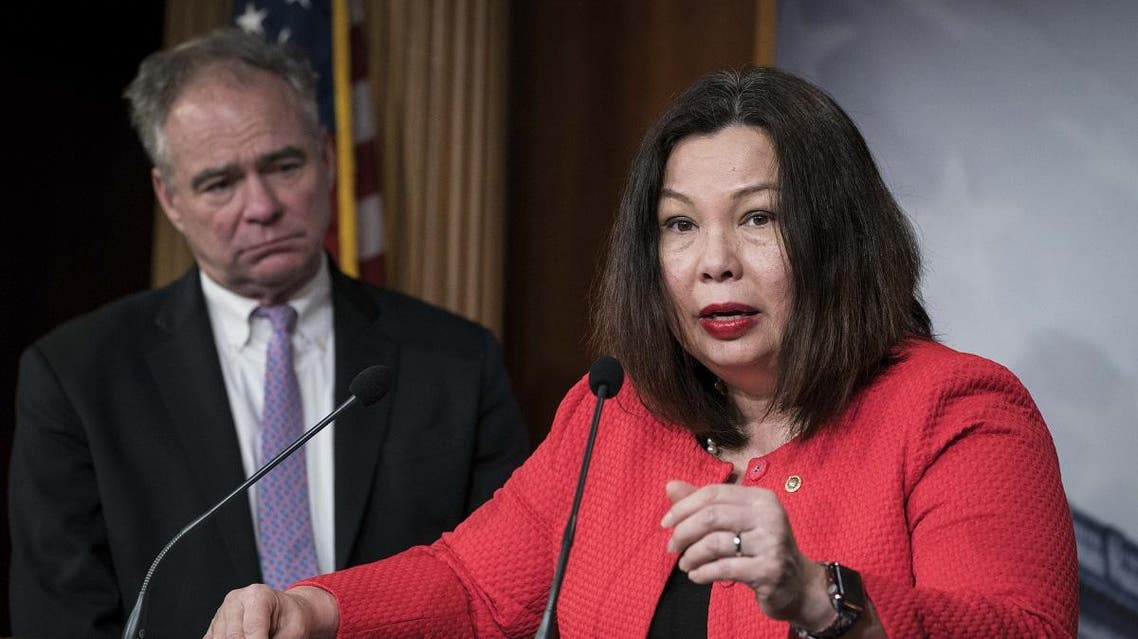 Senators Tammy Duckworth (D-IL) and Tim Kaine (D-VA) participate in a news conference following the bipartisan Senate vote on the War Powers Resolution on Iran at the U.S. Capitol on February 13, 2020 in Washington, DC. (AFP)