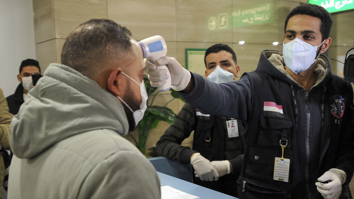 Egyptian Quarantine Authority employees prepare to scan body temperature for incoming travellers at Cairo International Airport on February 1, 2020, amidst efforts to detect possible cases of SARS-like Wuhan coronavirus (novel coronavirus 2019-nCoV).