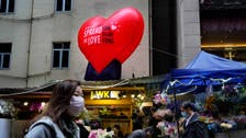 Virus-hit Hong Kong celebrates Valentine's Day with face masks