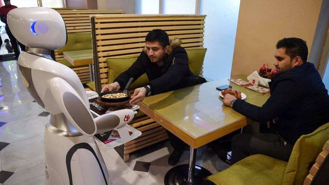 A waitress robot, named Timea, delivers food to customers at a Times Fast Food restaurant in Kabul on February 13, 2020. (AFP)