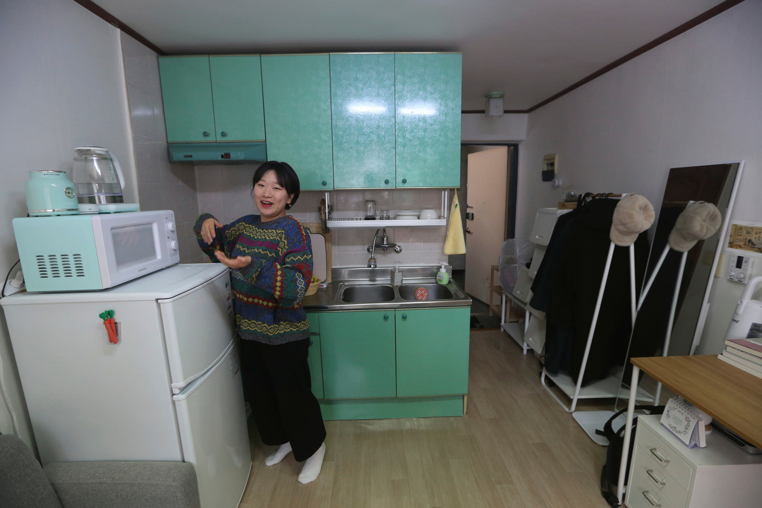 Kim Da-hye, a 29-year-old South Korean, talks about her semi-basement apartment in Seoul. (AP)