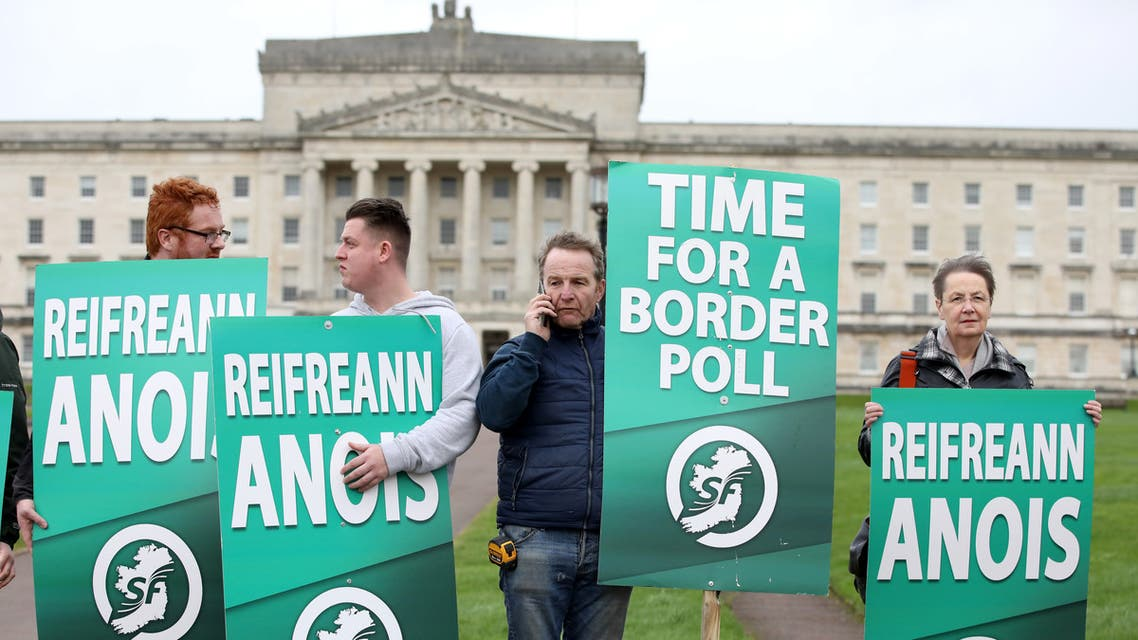 (FILES) In this file photo taken on January 31, 2020 Sinn Fein activists protest at the Parliament Buildings on the Stormont Estate in Belfast on January 31, 2020 against Brexit and call for a border poll on Irish Unity. A strong showing in the Irish general election on February 8, 2020 for Republican party Sinn Fein could result in their flagship policy of reuniting the Republic of Ireland and Northern Ireland becoming a key part of the next government's agenda.