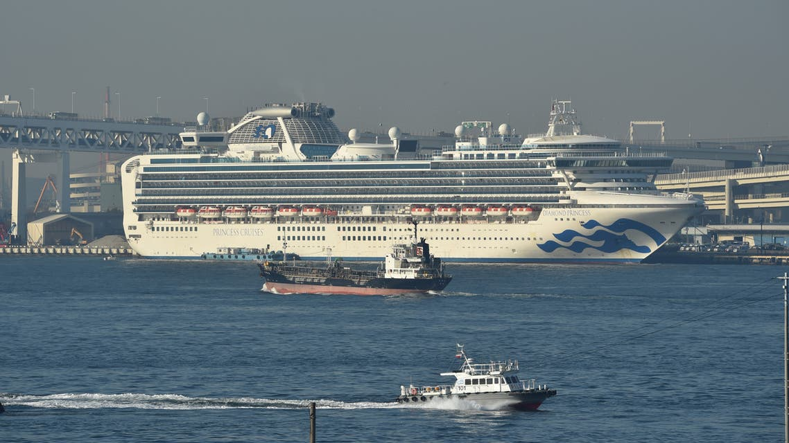 The Diamond Princess cruise ship is seen anchored at the Daikoku Pier Cruise Terminal in Yokohama port on February 13, 2020. At least 218 people on board a cruise ship quarantined off Japan have tested positive for the novel COVID-19 coronavirus, authorities said February 13 as they announced plans to move some elderly passengers off the ship.