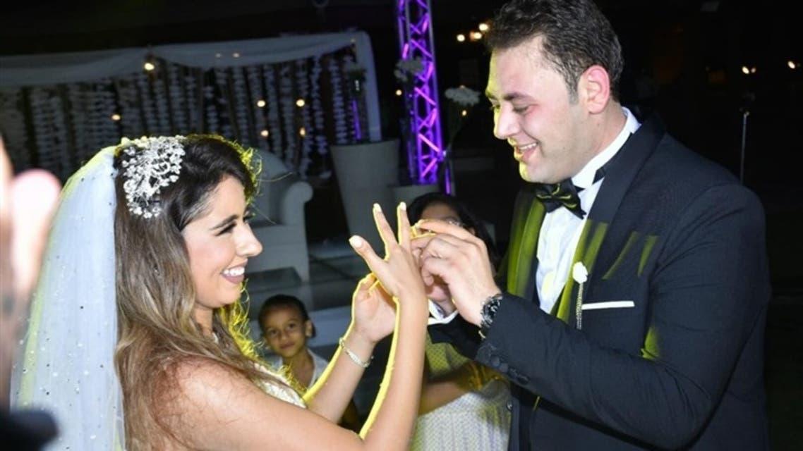 الفنان محمد علي رزق والإعلامية سارة فهيم في حفل زواجهما