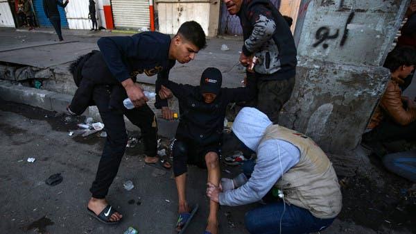 اشتباكات بين المتظاهرين والأمن وسط بغداد تخلف مصابين