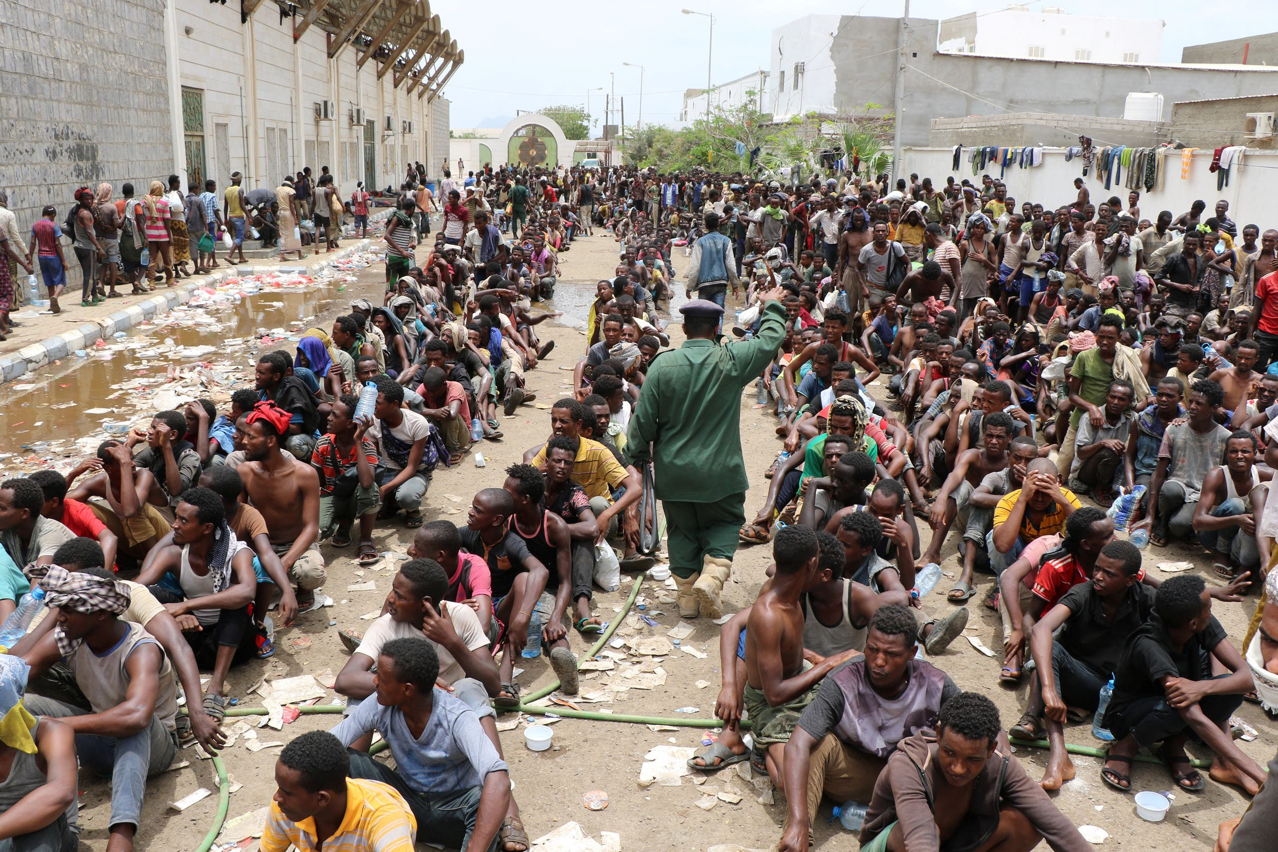 Ethiopian migrants, stranded in war-torn Yemen, sit on the ground of a detention site pending repatriation to their home country, in Aden, Yemen April 24, 2019. (Reuters)