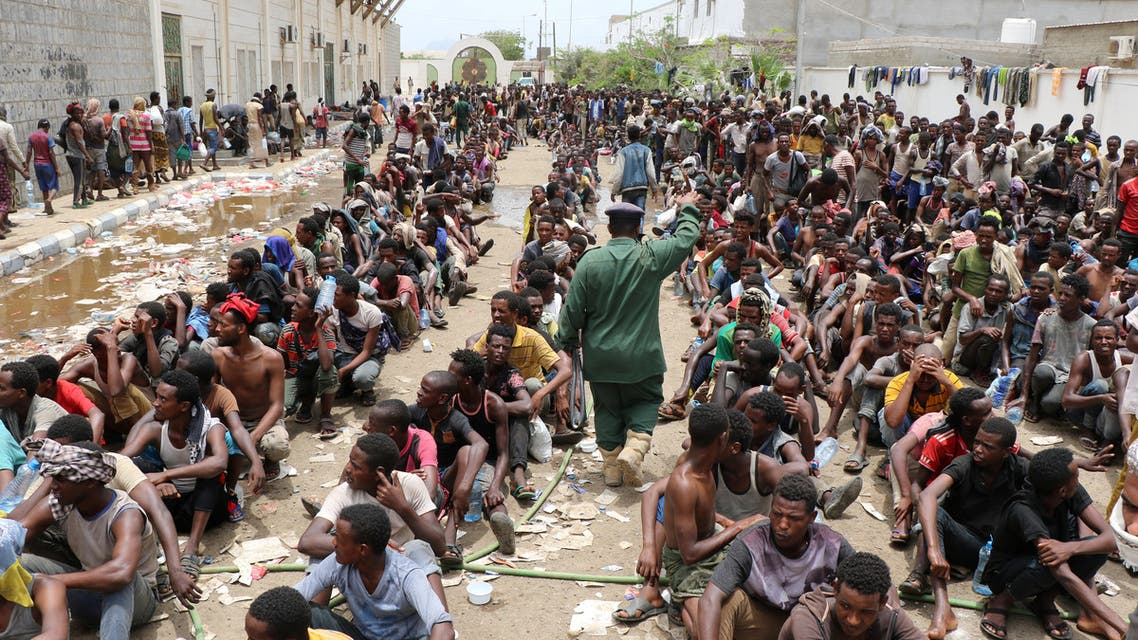 Ethiopian migrants, stranded in war-torn Yemen, sit on the ground of a detention site pending repatriation to their home country, in Aden, Yemen April 24, 2019. REUTERS/Fawaz Salman
