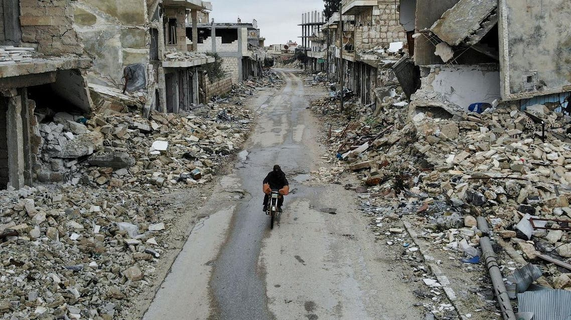 An aerial picture taken on February 15, 2020, shows a Syrian man on a motorbike in the deserted Syrian city of Kafranbel, south of Idlib city in the eponymous northwestern province, amid an ongoing pro-regime offensive. (AFP)