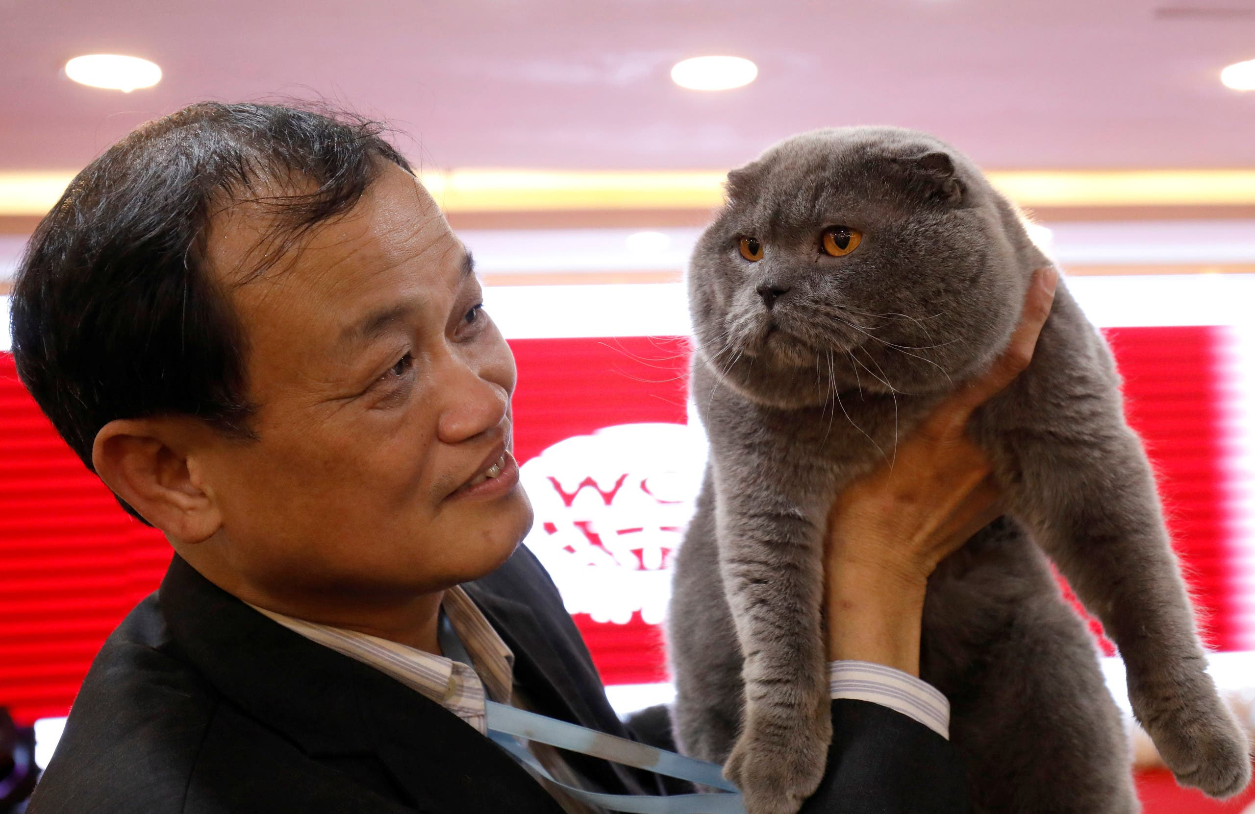 Dinh Chau Hieu Tam holds his cat during the Vietnam's first cat show in Hanoi, Vietnam February 16, 2020. REUTERS