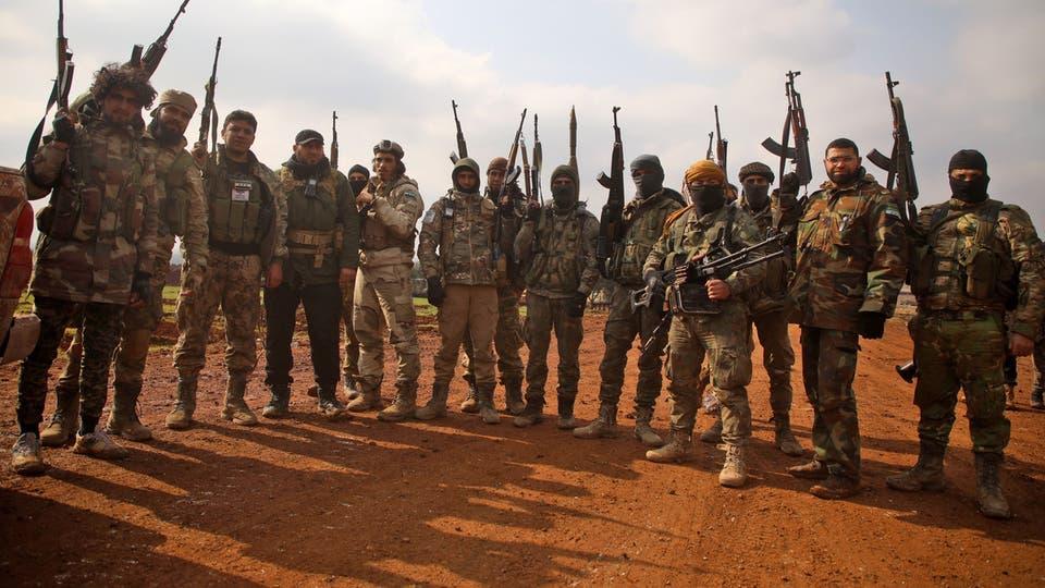 قوات من جبهة النصرة في إدلب (فرانس برس)