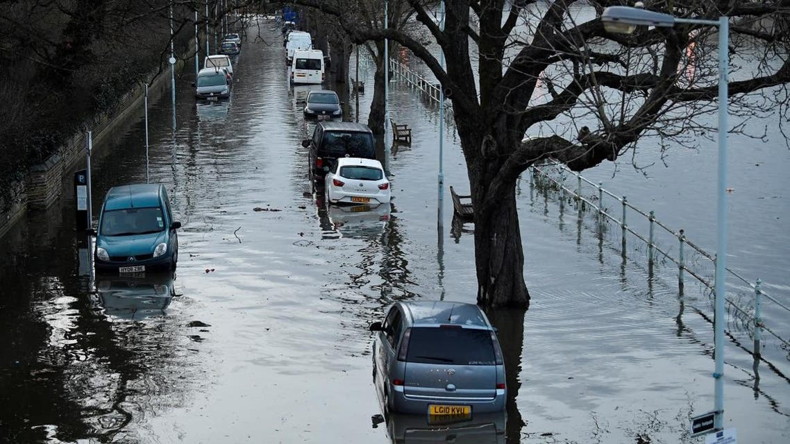 Cars are surrounded by water on a flooded road beside the River Thames in west London, Britain, February 12, 2020. (Photo: Reuters)