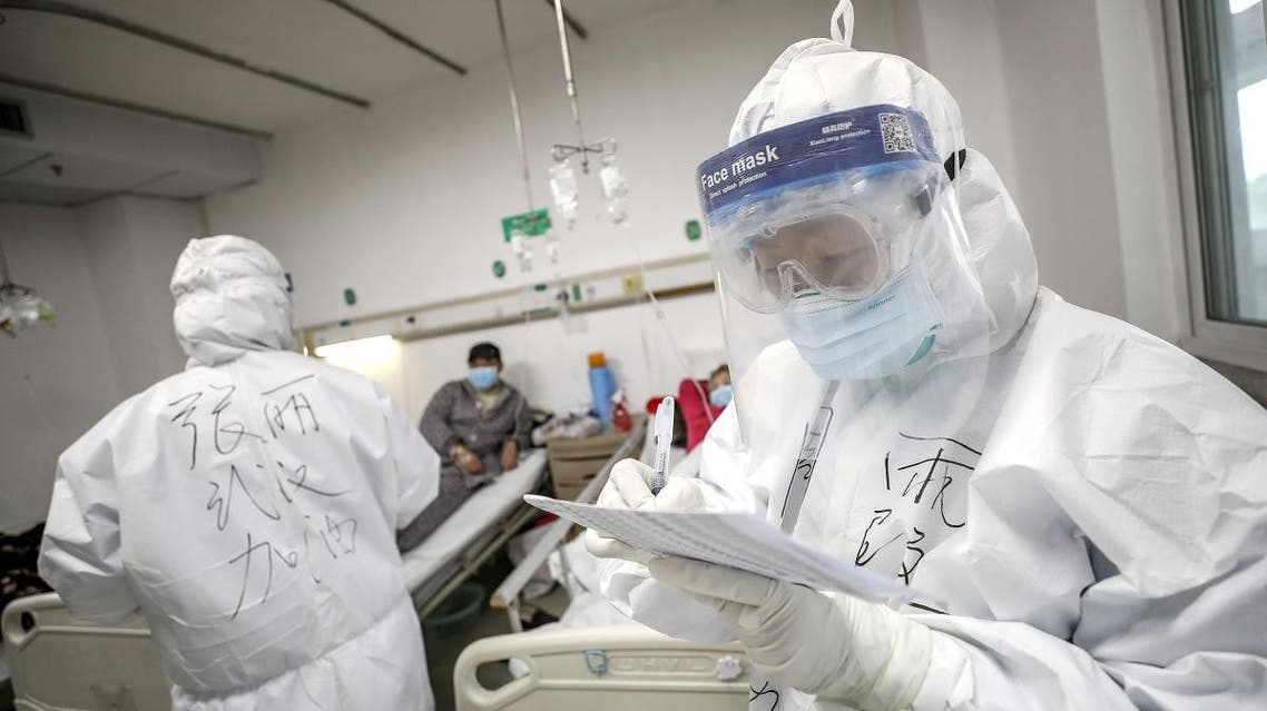 A medical worker in protective suit checks a patient's records at Jinyintan hospital in Wuhan, the epicentre of the novel coronavirus outbreak, in Hubei province, China February 13, 2020. (Reuters)