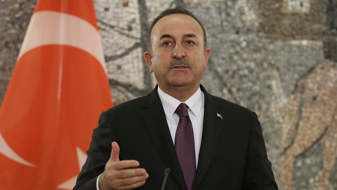 Turkey's Foreign Minister Mevlut Cavusoglu speaks during a joint news conference with Montenegro's Foreign Minister Srdjan Darmanoviç after their talks in Podgorica, Montenegro, Tuesday,. Feb. 11, 2020. (Turkish Foreign Ministry via AP, Pool)