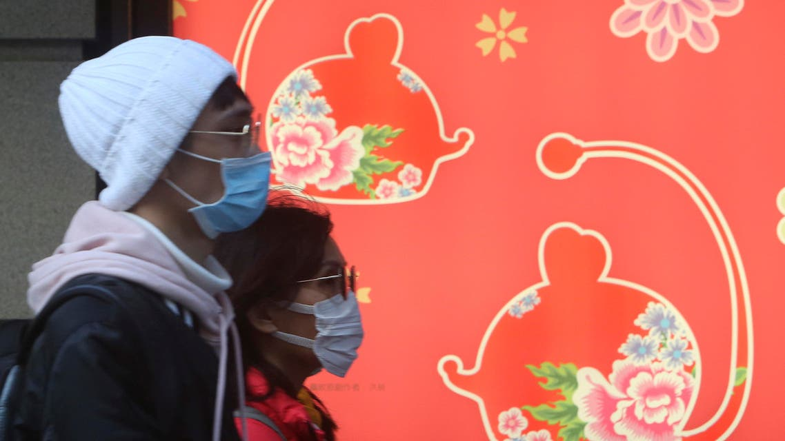 People wear face masks and walk through a shopping mall in Taipei, Taiwan, Friday, Jan. 31, 2020. (AP)