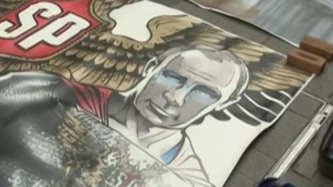 """A screengrab of a painting """"Putin  is superhero"""" by Russian artist Alexander Donskoy displayed  in central Istanbul on Feb. 15, 2020. (Reuters)"""