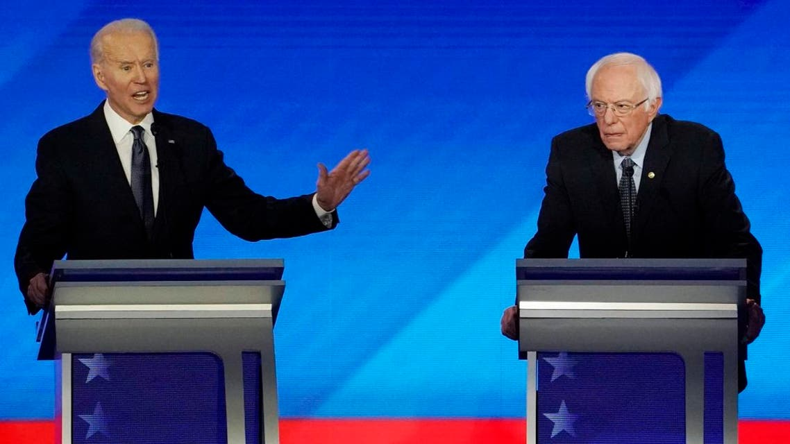 Democratic 2020 US presidential candidate and former VP Joe Biden speaks as Senator Bernie Sanders listens during the eighth Democratic 2020 presidential. (File photo: Reuters)
