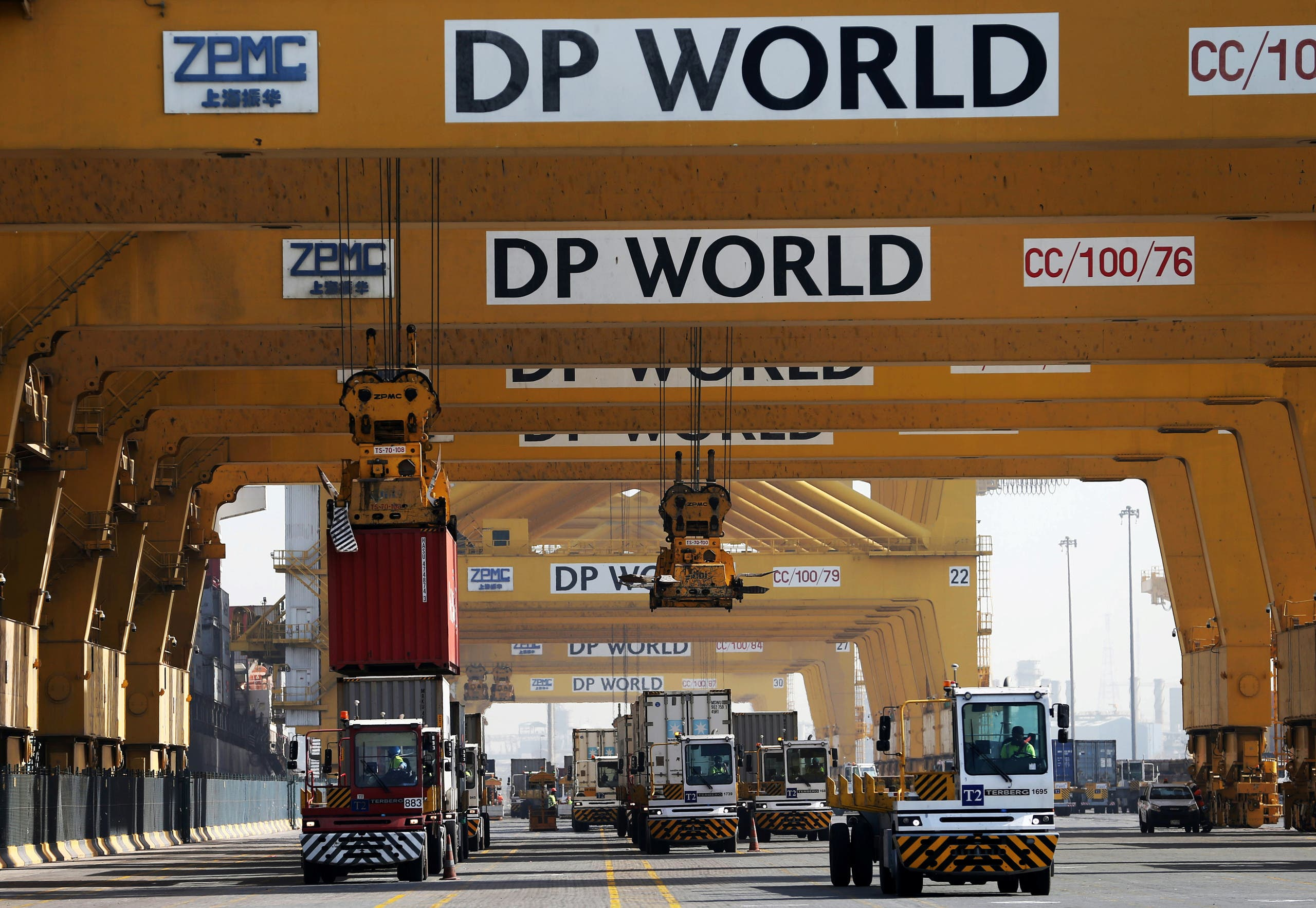Terminal tractors line up to offload their containers into a cargo ship at DP World's fully automated Terminal 2 at Jebel Ali Port in Dubai, United Arab Emirates, December 27, 2018. (Reuters)
