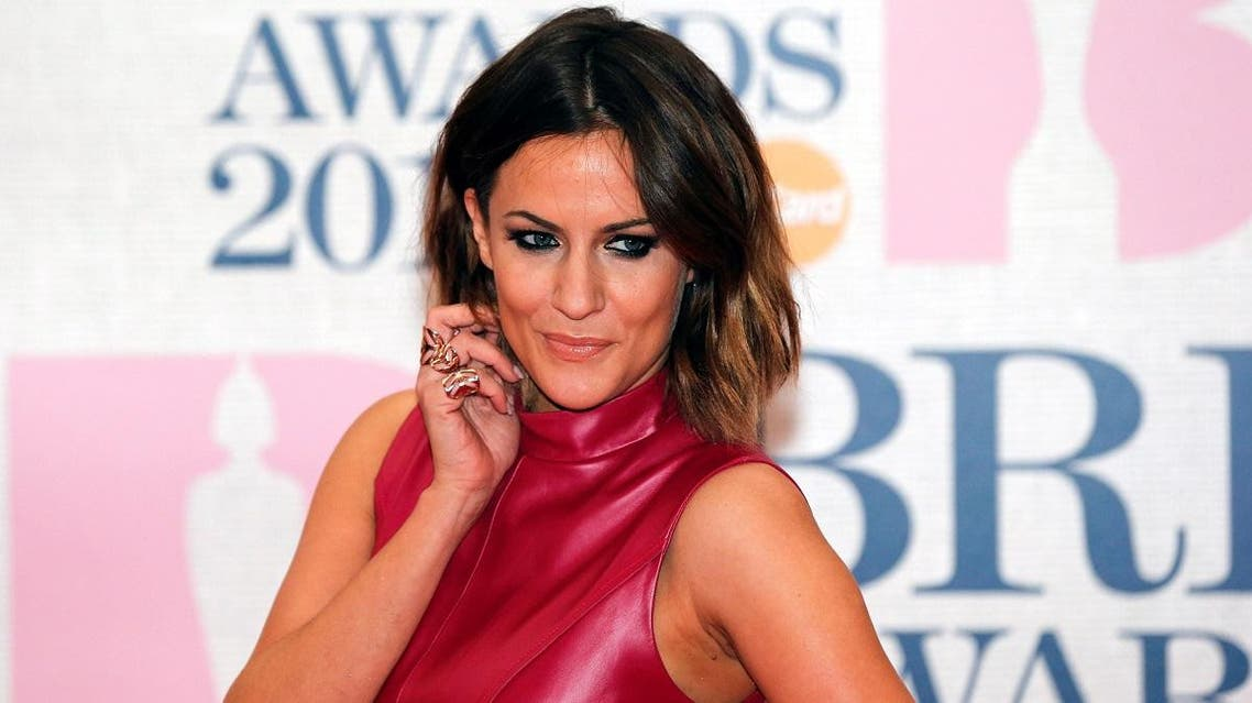 Television presenter Caroline Flack arrives for the BRIT music awards at the O2 Arena in London. (File photo: Reuters)
