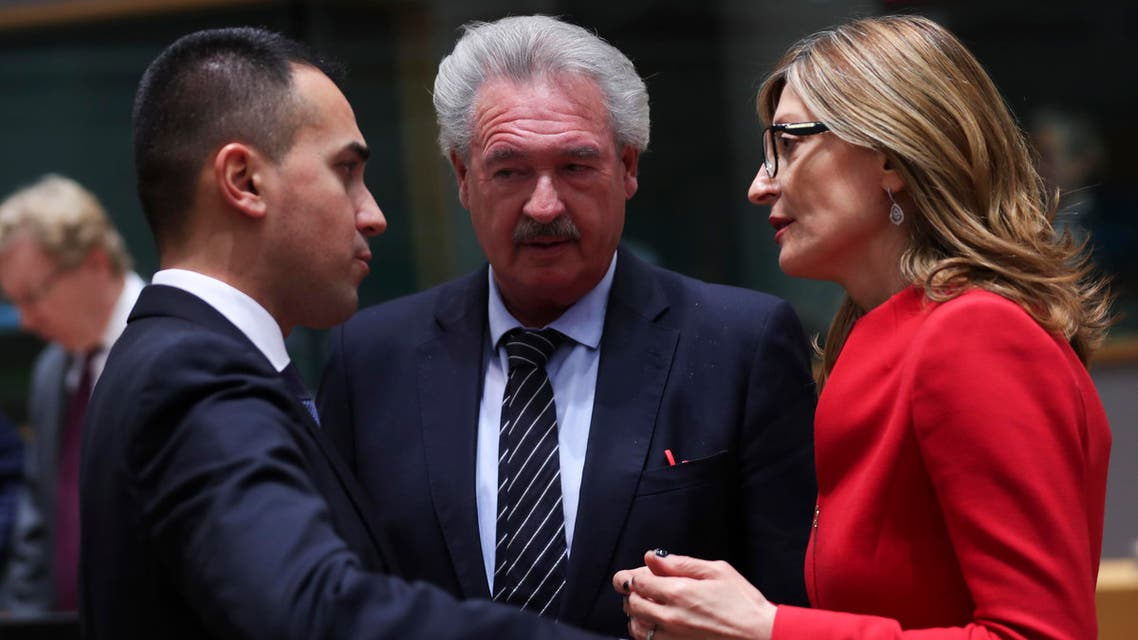 Luxembourg's Foreign Minister Jean Asselborn, center, talks to Italy's Foreign Minister Luigi di Maio and Bulgaria's Foreign Minister Ekaterina Zaharieva in Brussels on Feb. 17, 2020. (AP)