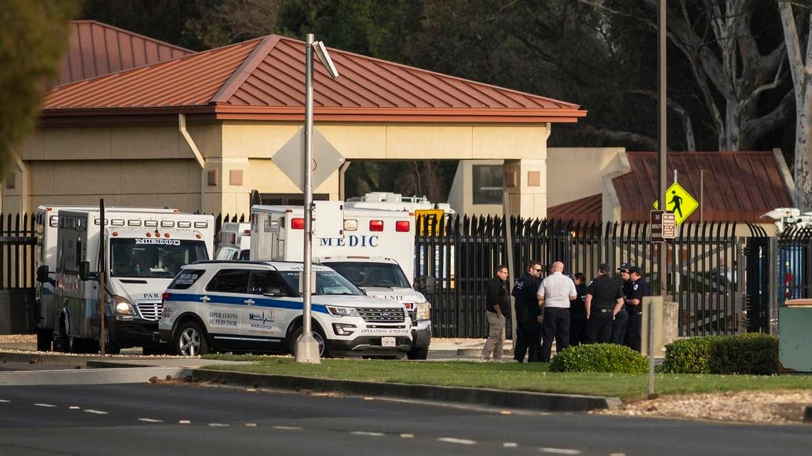 A group of ambulances from the Solano EMS Cooperative stage at the visitor center at Travis Air Force Base, adjacent to Fairfield, Calif., Sunday, Feb. 16, 2020. (AP)