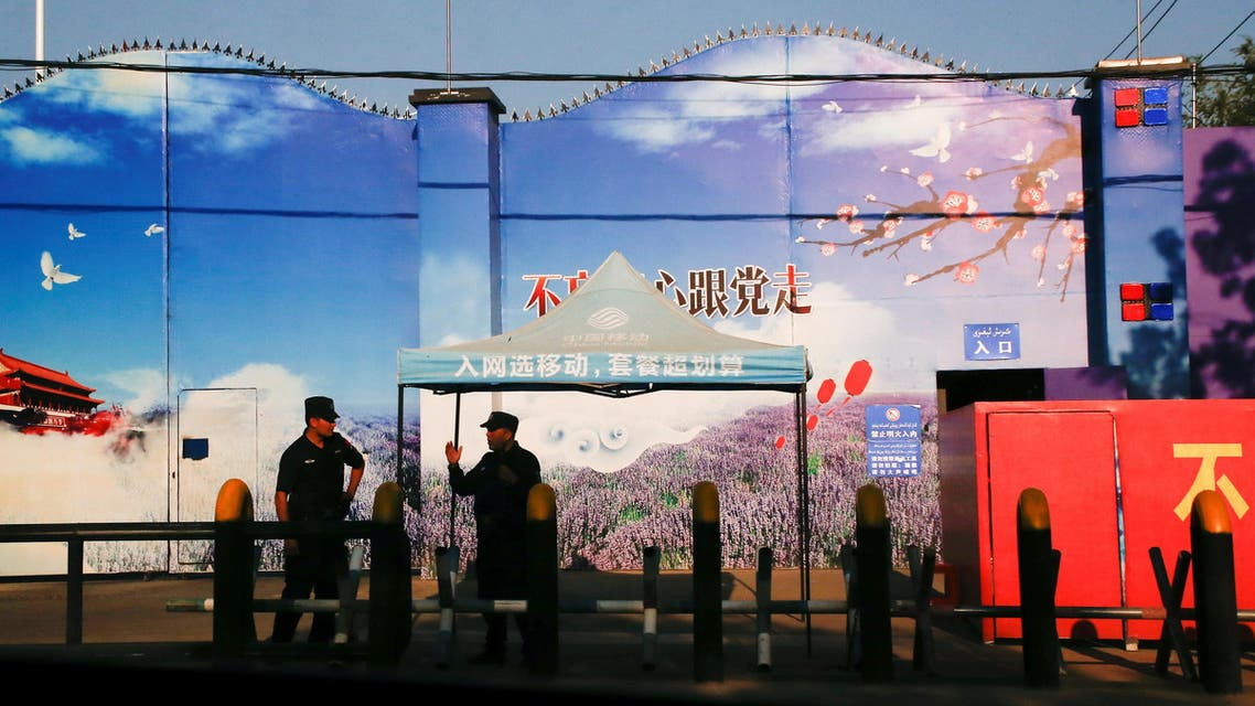 Security guards stand at the gates of what is officially known as a vocational skills education centre in Huocheng County. (Reuters)
