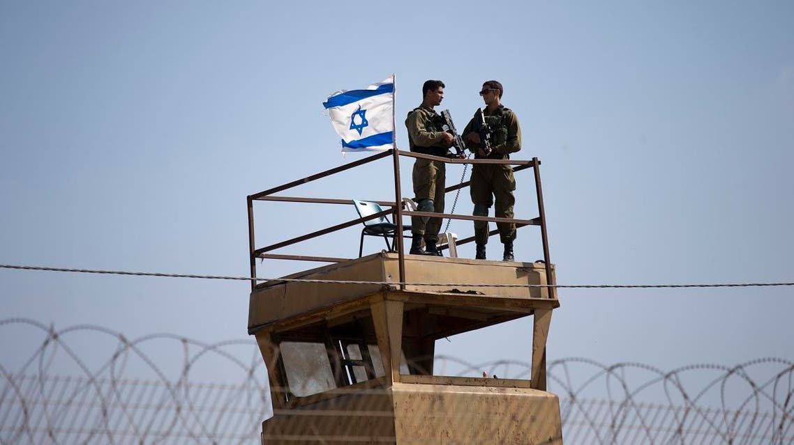 A file photo of Israeli soldiers guard on top of a watch tower in a community along the Israel- Gaza Strip Border. (File photo: AP)