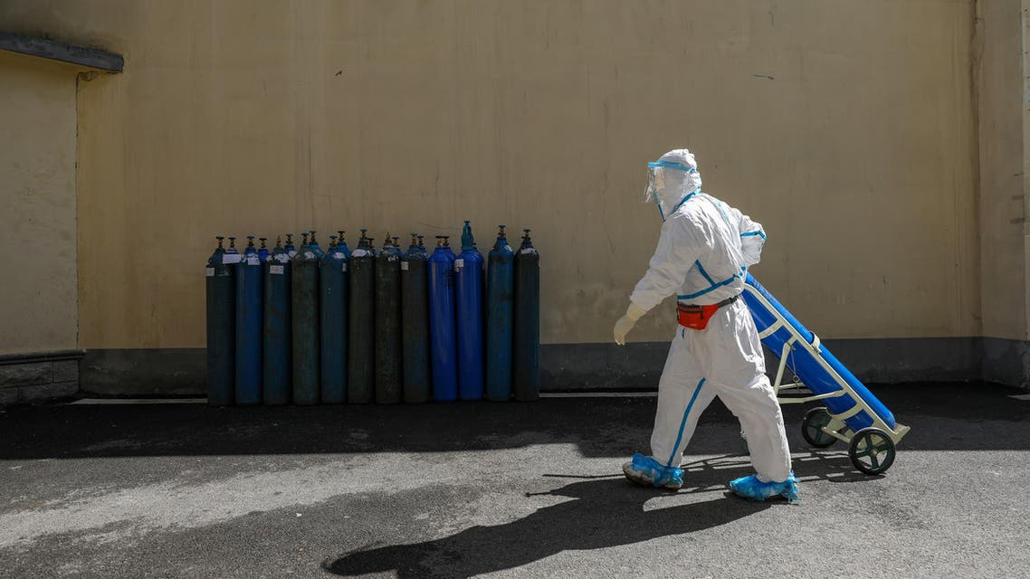 A medical worker in protective suit transports an oxygen tank at Wuhan Red Cross Hospital in Wuhan, the epicentre of the novel coronavirus outbreak, in Hubei province, China February 16, 2020. (Reuters)