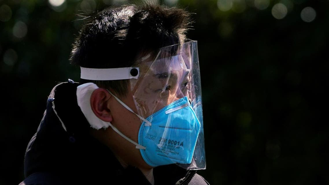 A man wears a face mask as a protection from coronavirus in Shanghai. (Reuters)