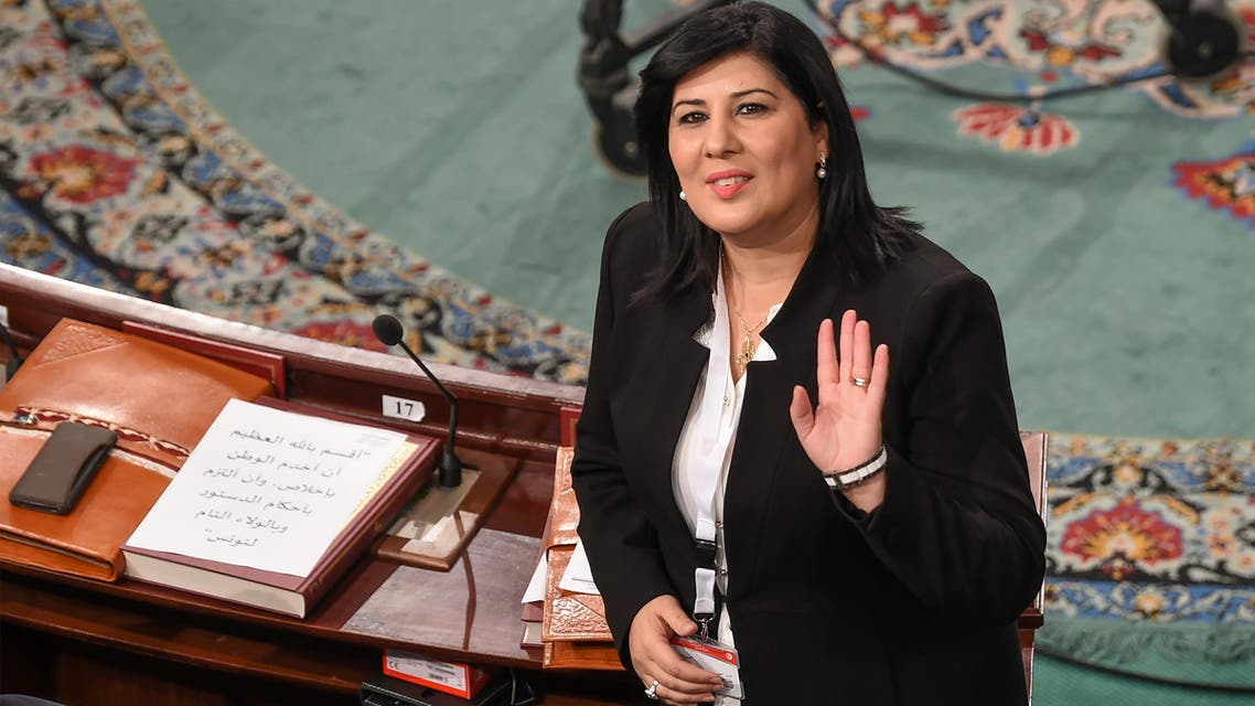 The leader of the Free Destourian Party (PDL) Abir Moussi waves as she attends the first session of parliament following October elections on November 13, 2019 in the Tunisian capital Tunis, calling it unconstitutional. Newly elected members of parliament gave a collective oath, whereas Moussi wanted them to swear one by one, and claimed some of them were not in the room at the time of the oath. It is the first clash on the floor of the Assembly between the anti-islamist lawyer Moussi and the leader of the Islamist-inspired Ennahdha party, Rached Ghannouchi, who hopes to be the new president of the Assembly.