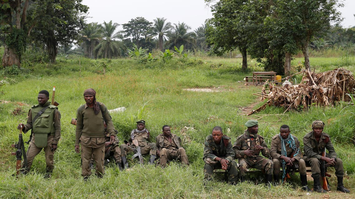 Armed Forces of the Democratic Republic of the Congo (FARDC) soldiers rest next to a road after Islamist rebel group called the Allied Democratic Forces (ADF) attacked area around Mukoko village, North Kivu province of Democratic Republic of Congo, December 11, 2018. (Reuters)