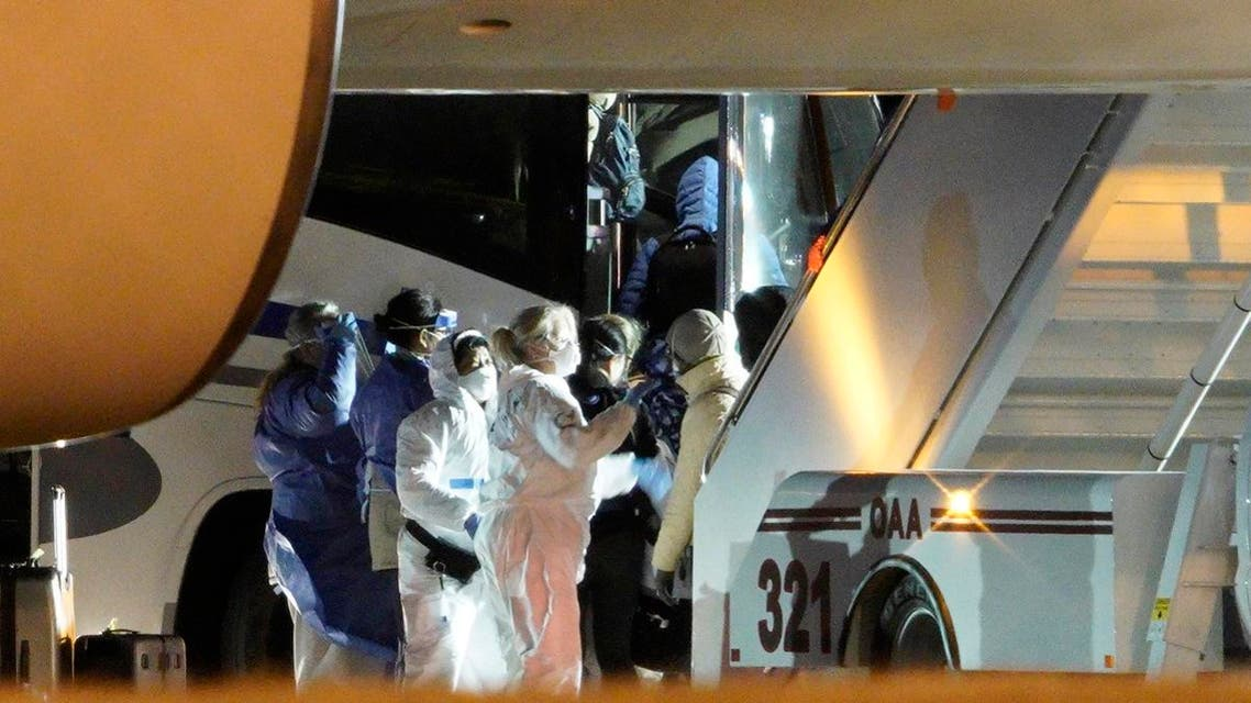 American evacuees from the coronavirus outbreak in China board a bus after arriving by flight to Eppley Airfield in Omaha, Neb. (AP)