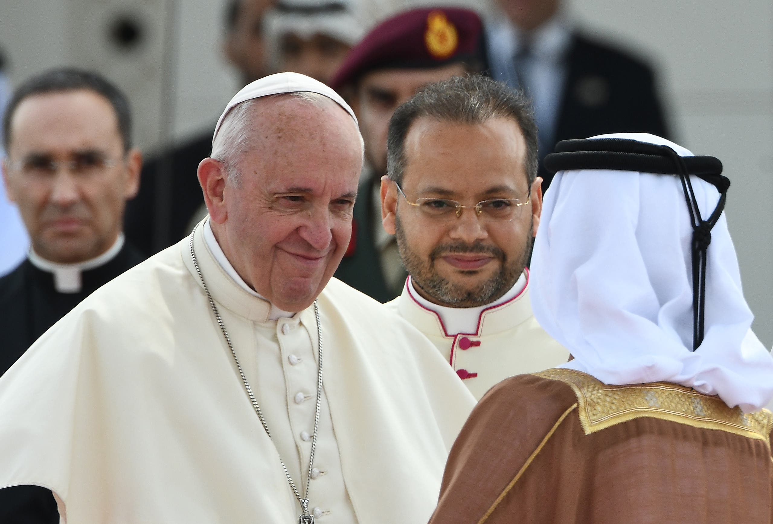 Pope Francis (L) shakes hands with a dignitary as he is accompanied by Abu Dhabi's Crown Prince Sheikh Mohammed bin Zayed al-Nahyan (R) during his welcome ceremony at the presidential palace in the UAE capital Abu Dhabi on February 4, 2019. (AFP)