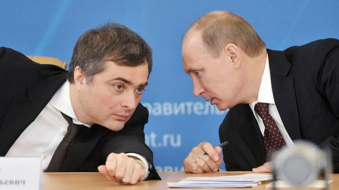 A file photo of Vladislav Surkov (R) speaking with Russian President Vladimir Putin. (File photo: Reuters)