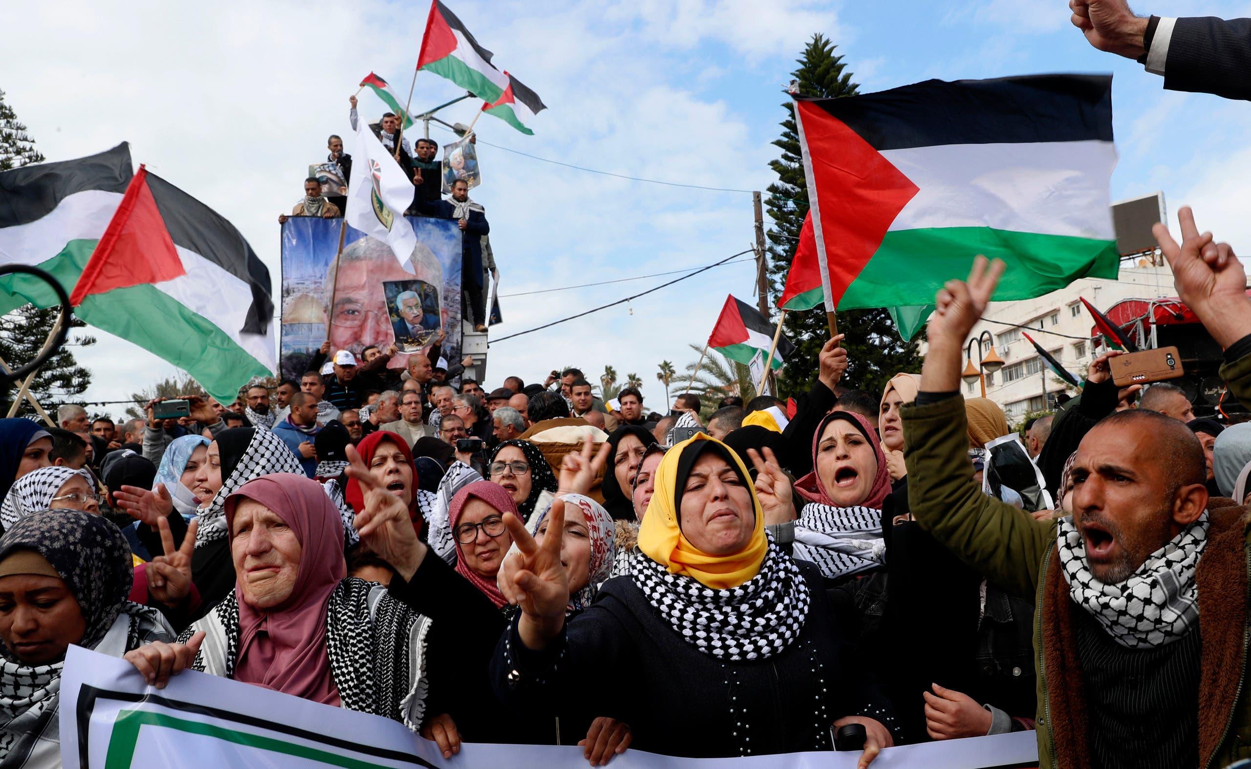 Protestors wave Palestinian flags in Gaza City on Feb. 11, 2020. (AP)
