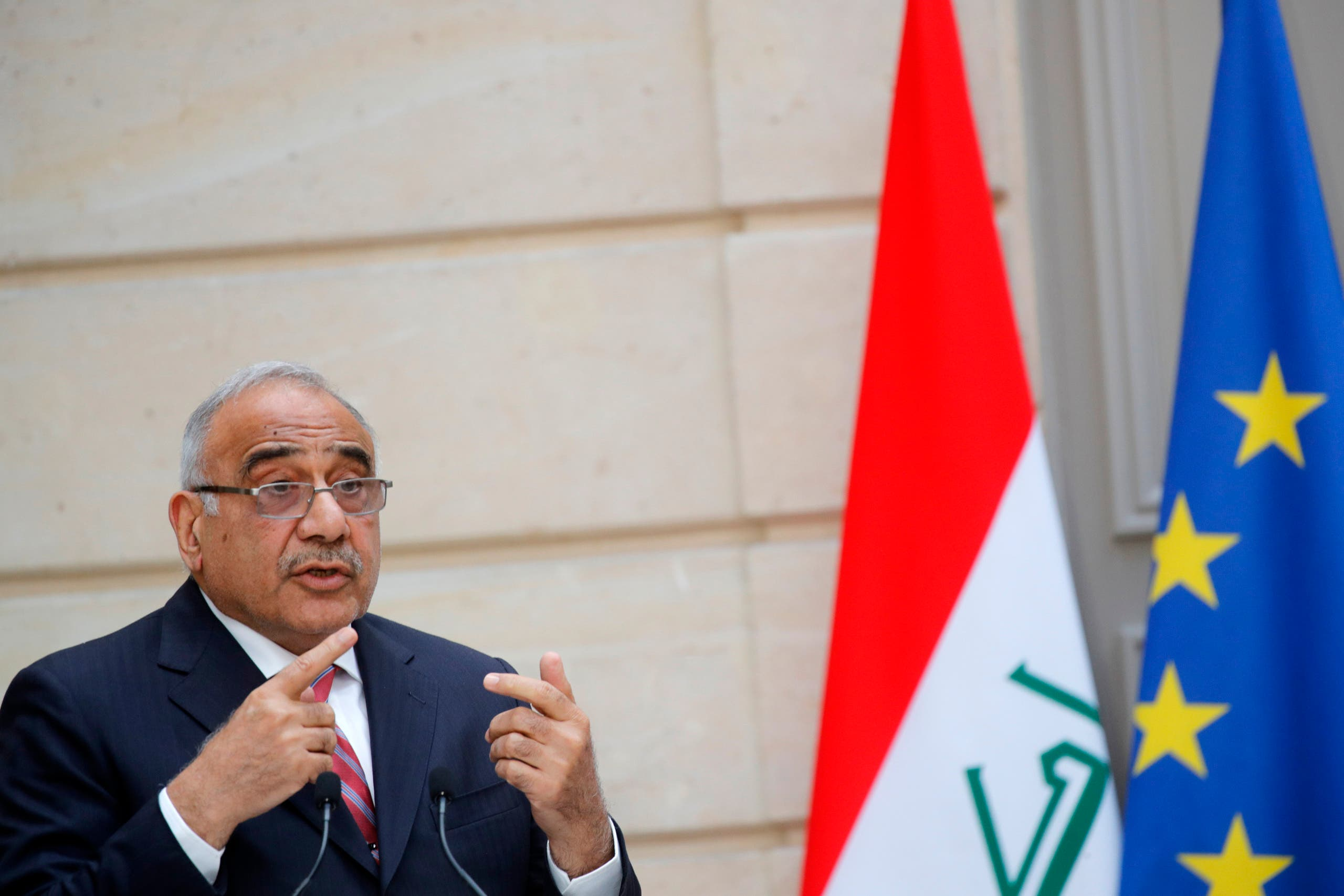 Then-Iraqi Prime Minister Adel Abdul Mahdi speaks during a joint statement with French President at the Elysee Palace in Paris, on May 3, 2019. (AFP)