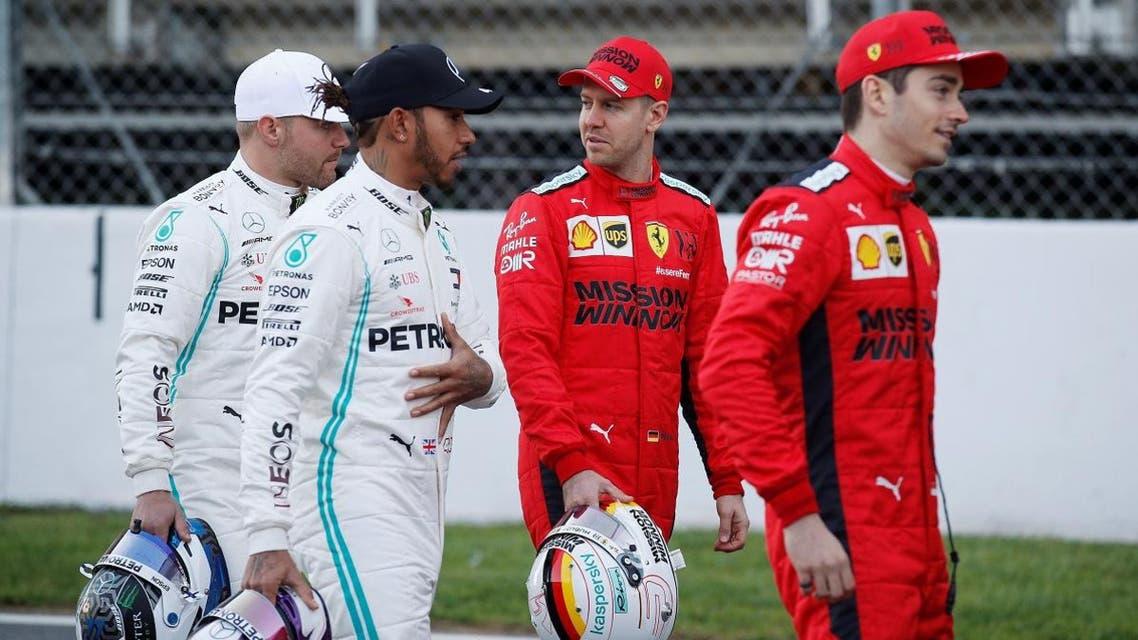 Ferrari's Sebastian Vettel speaks to Mercedes' Valtteri Bottas and Lewis Hamilton alongside Ferrari's Charles Leclerc before testing at the Circuit de Barcelona-Catalunya, Barcelona, Spain, on February 19, 2020. (Reuters)