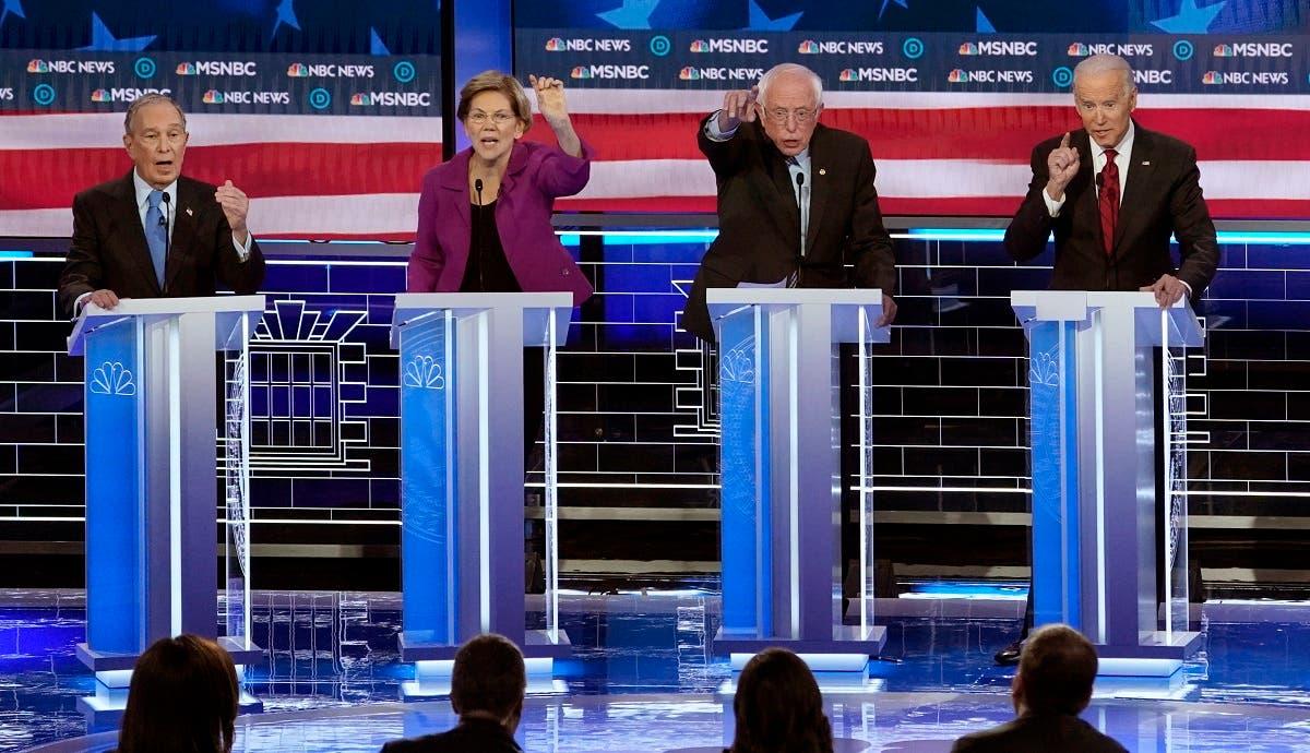 Former NYC Mayor Bloomberg, Senator Warren, Senator Sanders and former VP Biden (L-R) all speak simultaneously at the ninth Democratic 2020 US Presidential debate. (Reuters)