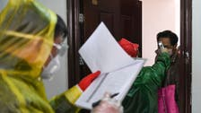 China says number of new virus cases rose by just 394