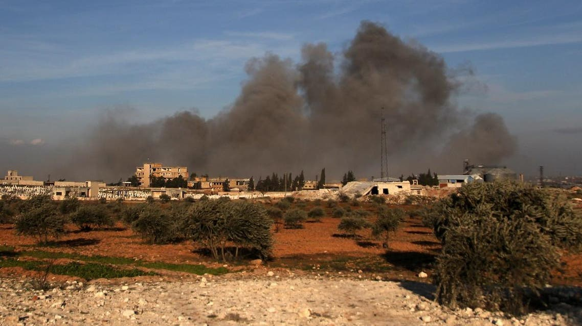 This picture taken on February 20, 2020 shows smoke plumes rising following a reported air strike near a Turkish military observation point between the northwestern Syrian city of Idlib and the neighbouring town of Qaminas. (AFP)