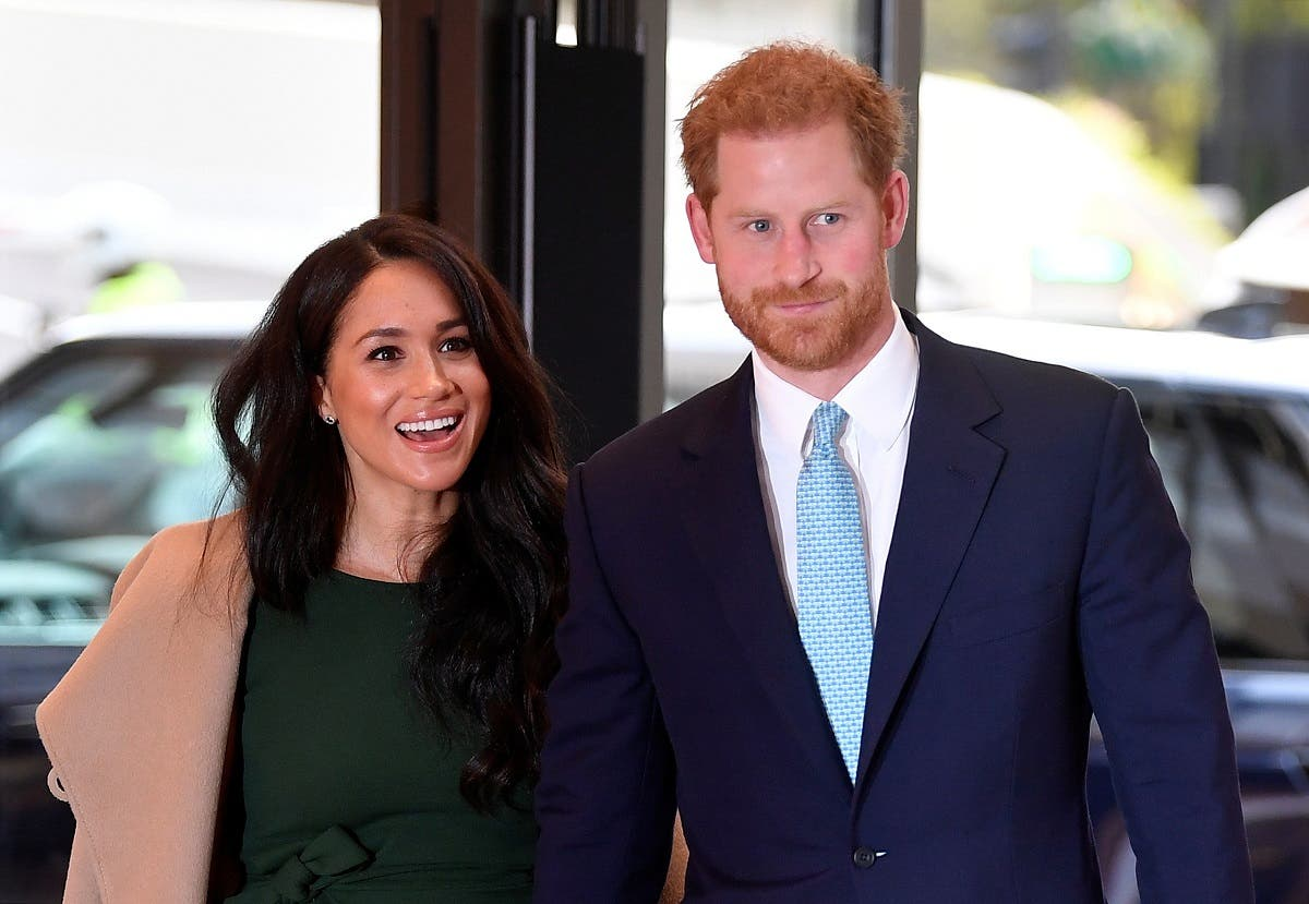 Britain's Prince Harry, Duke of Sussex (R), and his wife Meghan, Duchess of Sussex attend the annual WellChild Awards in London on October 15, 2019. (AFP)
