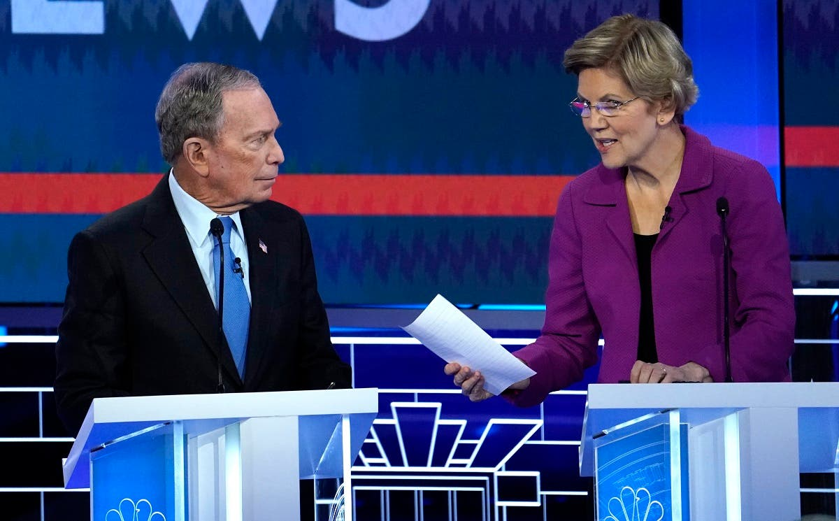 Former New York City Mayor Mike Bloomberg talks with Senator Elizabeth Warren during a break at the ninth Democratic 2020 U.S. Presidential candidates debate at the Paris Theater in Las Vegas Nevada, U.S., February 19, 2020. (Reuters)