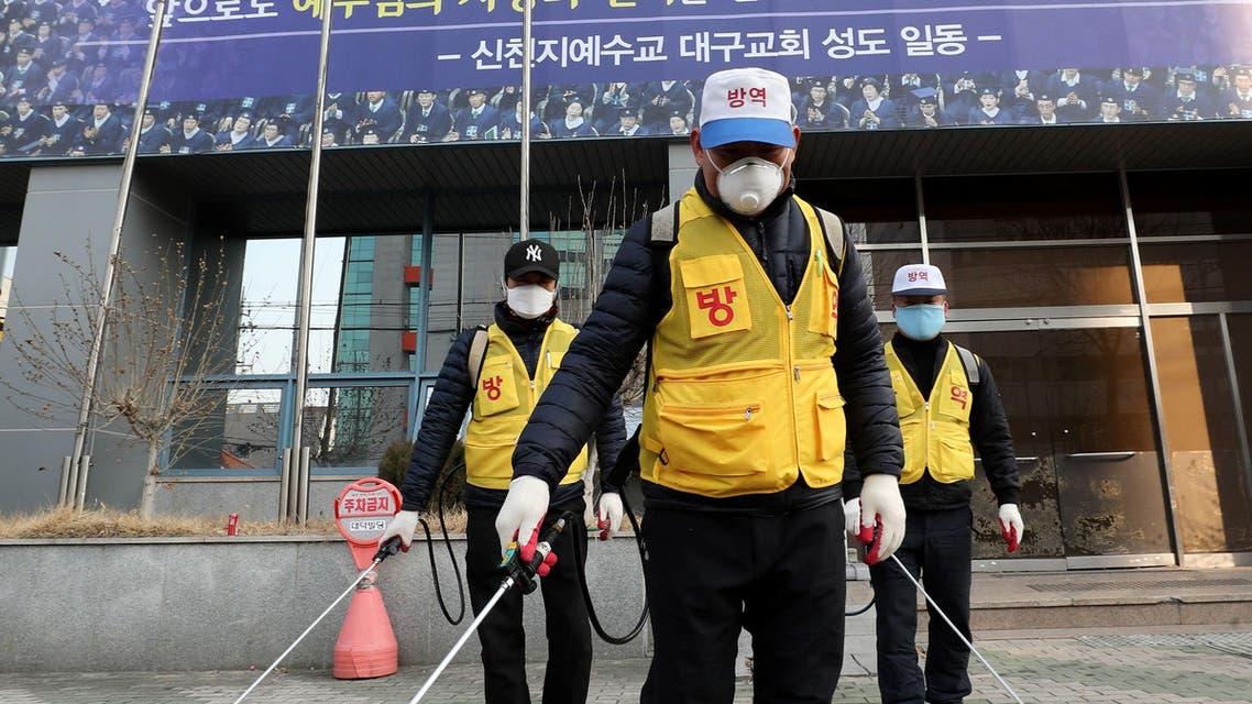 Korean staff disinfect outside the Shincheonji Church of Jesus, Korea, after a coronavirus outbreak - AFP