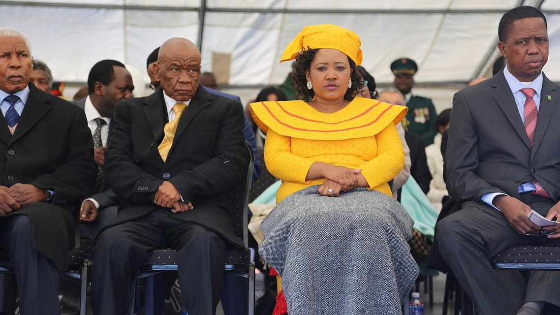 Newly appointed Lesotho prime Minister Thomas Thabane (L), leader of the All Basotho Convention (ABC) political party, his wife Maesaiah Thabane and Zambian President Edgar Lungu (R) attend Thabane's inauguration on June 16, 2017 in Maseru. Lesotho's new prime minister took office at the head of a coalition government, three years after he was targeted by a putsch and two days after the murder of his estranged wife.